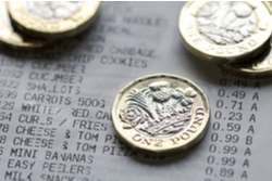 One-pound coins on a food shopping receipt